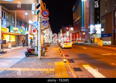Aomori, Japan - April  23 2018: Night scene at Aomori mainstreet whith shopping malls market and Aomori train station at the the end of the street - Stock Photo