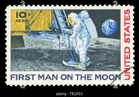 UNITED STATES - CIRCA 1969: A stamp printed in USA shows Neil Armstrong, first step on the moon, circa 1969. - Stock Photo