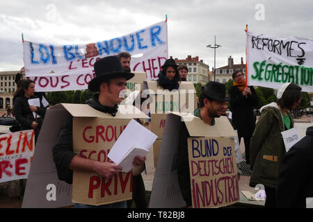 Protesters take part in a short sketch to protest against government reforms and defend civil Services, Lyon, France
