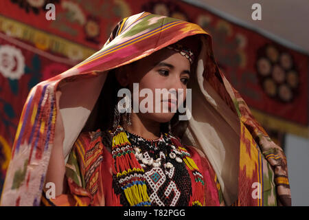 Young Uzbek woman wearing traditional embroidered costume in the Surkhandarya style in the town of Jarkurgan in Surxondaryo Region in Uzbekistan - Stock Photo