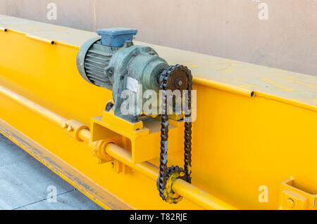 Parts of a crane ready for installation in the industrial plant. Overhead crane commonly called a bridge or gantry crane is a type of crane found in i - Stock Photo