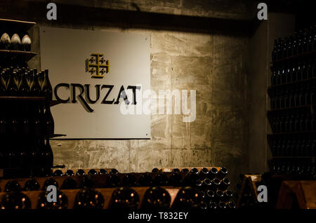Mendoza, Argentina - April 15th 2019: Logo and interior of sparkling wine leader Cruzat. - Stock Photo