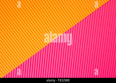 Abstract geometric paper background in vibrant orange and pink trendy colors with diagonal line. - Stock Photo