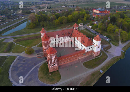Aerial view of Mir Castle on April evening. Belarus - Stock Photo
