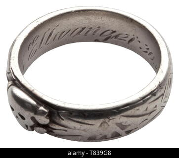 An SS honour ring custom-made by the jeweller Gahr in Munich, soldered underneath the separately applied death's head, the inside surface with engraved dedication 'S.lb. Ellwanger 30.VI.34 H. Himmler'. Weight 9.7 grammes, inside diameter 20 mm, heavily used. The ring comes from family possession and has never been in collectors´ hands before. historic, historical, 20th century, 1930s, 1940s, Waffen-SS, armed division of the SS, armed service, armed services, NS, National Socialism, Nazism, Third Reich, German Reich, Germany, military, militaria, utensil, piece of equipment, Editorial-Use-Only - Stock Photo