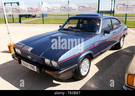 Three-quarters front  view of a Blue, 1984, Ford Capri , part of the 50th Anniversary celebrations at the 2019 Silverstone Classic Media Day - Stock Photo