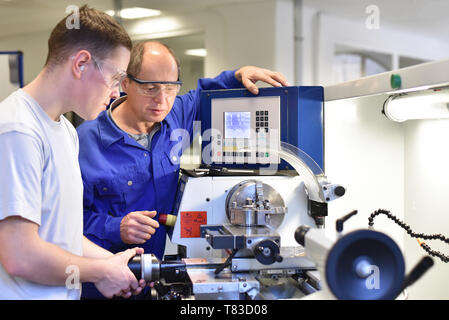 Group of young people in technical vocational training with teacher - Stock Photo