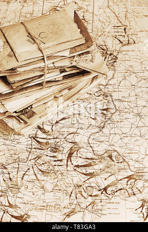 Sheaf of the paper letters of the wartime lying on the military map of the World War II, 1944 - Stock Photo