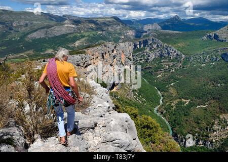 France, Alpes de Haute Provence, Parc Naturel Regional du Verdon, Grand Canyon of Verdon river, La Palud Sur Verdon, point of view of the Dent d'Aire, Bernard Gorgeon one of the pioneers of climbing in the massif and the Escales cliff in the background - Stock Photo
