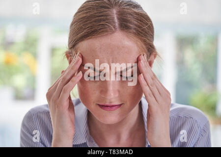 Close Up Shot Of Young Woman Suffering With Headache - Stock Photo