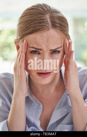 Portrait Of Young Woman Suffering With Headache - Stock Photo