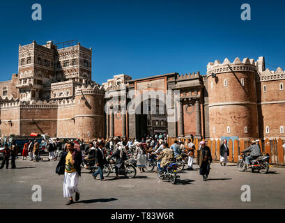 street scene and local heritage architecture buildings in old town of sanaa yemen at Bab Al Yemen gate - Stock Photo
