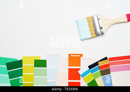 Photo of palette with blue and green, red colors, brush, on blank white background. - Stock Photo