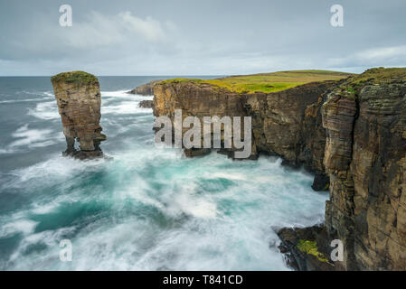 Yesnaby Castle sea stack off the coast of Orkney on a blustery day, Scotland - Stock Photo