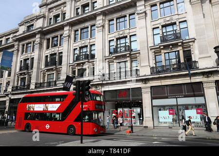 LONDON, UK - JULY 7, 2016: People shop at Regent Street in London. Regent Street is a major shopping street in West End of London. - Stock Photo