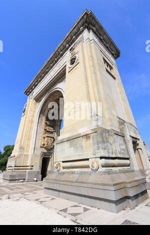 Bucharest, capital city of Romania. Arcul de Triumf - triumphal arch, symbol of independence. - Stock Photo