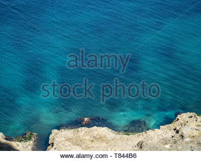 Clear turquoise sea in the Caribbean, with tiny ripples from the breeze - Stock Photo