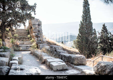 The site of an ancient bronze foundry of the hill slopes below the Acropolis of Athens. The Acropolis is an ancient citadel standing on a rocky outcro - Stock Photo
