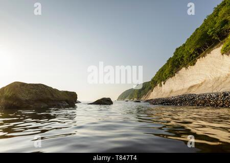 Seascape with chalk cliffs and blue sky, Jasmund National Park, Sassnitz, Rugen, Mecklenburg-Vorpommern, Germany - Stock Photo