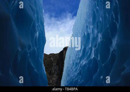 Crystal blue ice on the Franz Josef Glacier, West coast, New Zealand - Stock Photo