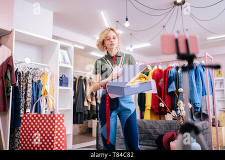 Fashion stylish in nice jeans speaking while making blog for followers - Stock Photo