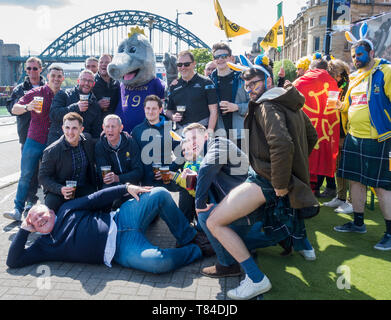 Newcastle upon Tyne, UK. 10th May 2019. A friendly atmosphere in the Fanzone village on The Quayside as  thousands of French, Irish and English rugby fans descend on Newcastle for the 2019 European Rugby Champions Cup Finals. French clubs ASM Clermont Auvergne and La Rochelle will contest the Challenge cup final on 10th May (7.45pm) while Irish club Leinster and London club Saracens will contest the Champions cup final on Sat 11th May (5.pm). Both finals will be played at 52,000 capacity St. James' Park. Credit: Alan Dawson/Alamy Live News - Stock Photo