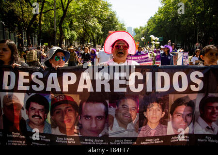 Mexico City, Mexico. 10th May, 2019. Women march with pictures of their abducted relatives in a protest, through which they demanded information about the fate of their children and relatives. In Mexico, about 40,000 people are considered missing. Many may have been killed. They are often victims of powerful drug cartels and crime syndicates. Credit: Jair Cabrera Torres/dpa/Alamy Live News - Stock Photo