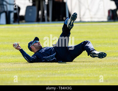 The Grange, Edinburgh, Midlothian, UK. 10th May 2019. Scotland v Afghanistan ODI. Pic shows: A brilliant catch by Scotland captain, Kyle Coetzer, to dismiss Afghanistan's Hazratullah Zazai, for 14 during the second innings as Scotland take on Afghanistan in a One Day International at the Grange, Edinburgh Credit: Ian Jacobs/Alamy Live News - Stock Photo