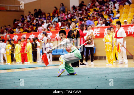 Beijing, China. 10th May, 2019. A student performs broadsword play during a Wushu (Chinese martial arts) competition in Ditan stadium, Beijing, captial of China, May 10, 2019. Credit: Zhou Liang/Xinhua/Alamy Live News - Stock Photo