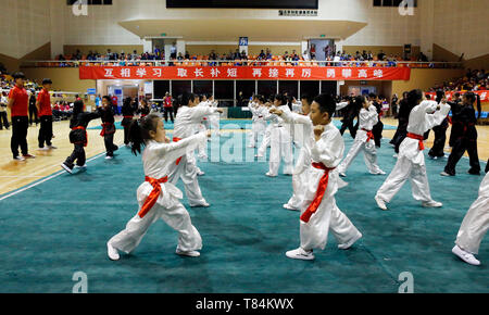Beijing, China. 10th May, 2019. Students participate in a Wushu (Chinese martial arts) competition in Ditan stadium, Beijing, captial of China, May 10, 2019. Credit: Zhou Liang/Xinhua/Alamy Live News - Stock Photo