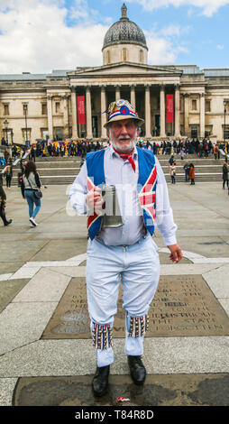 London, UK. 11th May 2019. Morris dancers ,from all over England ,decended in Trafalgar Square ,and not even the rain stopped them from having a dance in their colourful costumes and hats .Paul Quezada-Neiman/Alamy Live News - Stock Photo