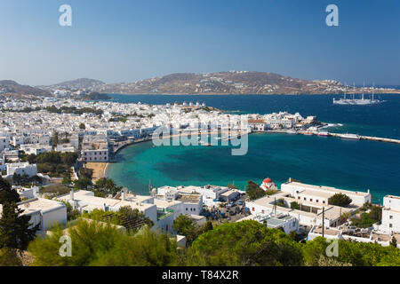 Mykonos Town, Mykonos, South Aegean, Greece. View over the town and harbour from hillside. - Stock Photo