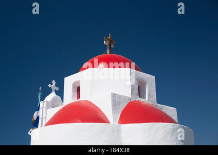 Tourlos, Mykonos, South Aegean, Greece. The red-domed Church of Agia Sofia beneath a deep blue sky. - Stock Photo