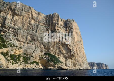 Sheer limestone cliffs at Capo di Monte Santu, Gennargentu National Park, Gulf of Orosei, near Baunei, Sardinia, June 2018. - Stock Photo