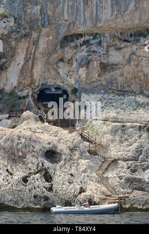 Entrance to Grotta del Fico limestone caves complex, Gulf of Orosei, Gennargentu National Park, Baunei, Sardinia, Italy, June 2018. - Stock Photo