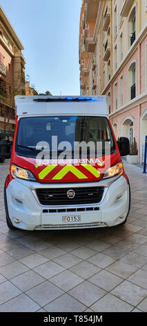 Monte-Carlo, Monaco - March 28,  French Red And White Fire Department Ambulance (Front View) Van Parked In The Street Of Monaco, With Lights, French R - Stock Photo