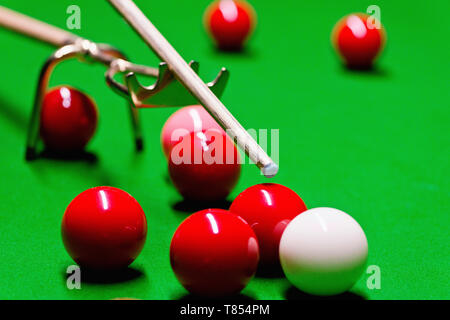 Snooker cue on spider rest - Stock Photo