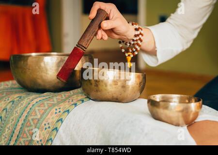 Tibetan singing bowl therapy - Stock Photo