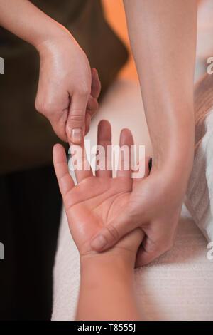 Hand Sports Massage Therapy - Stock Photo