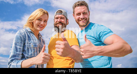 Best choice. Friends having fun summer open air festival. Men and woman enjoy summer vacation. Vacation and entertainment. Visit famous festival during vacation. Highly recommend to visit. Good job. - Stock Photo