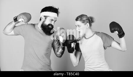 Losers complain champions train. Happy woman and bearded man workout in gym. knockout and energy. couple training in boxing gloves. punching, sport Success. sportswear. Fight. training with coach. - Stock Photo