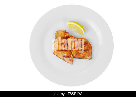 Fish, trout, keta, pink salmon, a pieces baked, fried over an open fire, with slice of lemon. Appetizing on white isolated background, view from above - Stock Photo