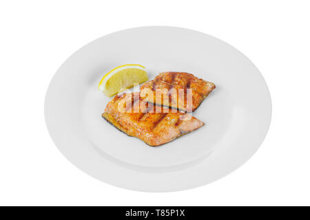 Fish, trout, keta, pink salmon, a piece, baked, fried over an open fire, with a slice of lemon. Appetizing on white isolated background side view - Stock Photo