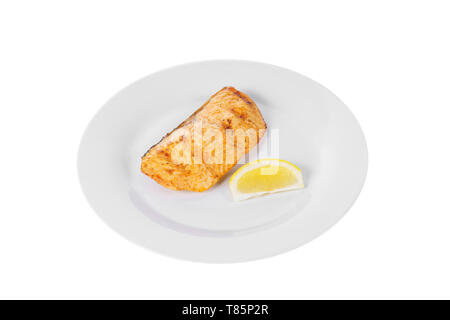 Fish, trout, keta, pink salmon, a piece, baked, fried over an open fire with a slice of lemon. Appetizing on white isolated background side view - Stock Photo