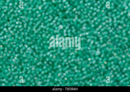 Abstract background of green blured holiday lights. - Stock Photo