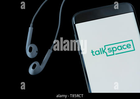 Image of Talkspace app on a smartphone on a black background - Stock Photo