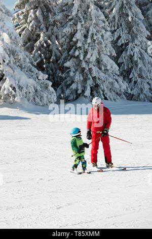 Boy having skiing lesson - Stock Photo