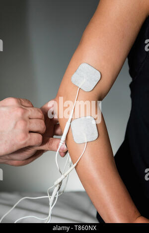 TENS therapy - Stock Photo