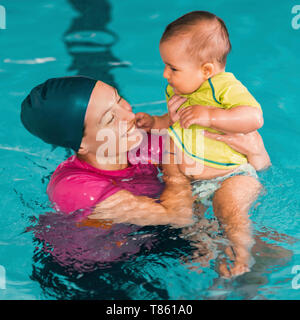 Baby swimming lesson - Stock Photo