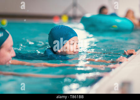 Boy in swimming class - Stock Photo